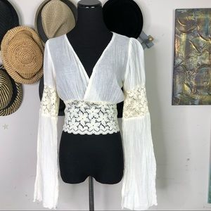 Arielle Cream blouse with deep V-neck